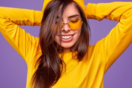 Urban young woman with closed eyes Stock Photo