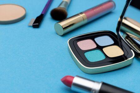 Various cosmetics near set of eyeshadows Stockfoto