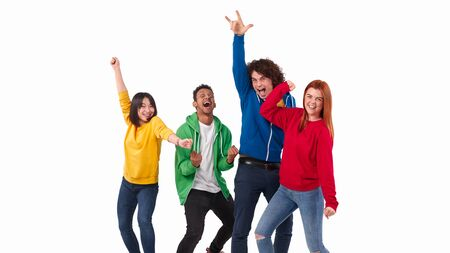 Excited diverse people dancing in victory celebration Stockfoto