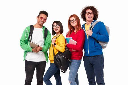 Cheerful diverse students smiling at camera