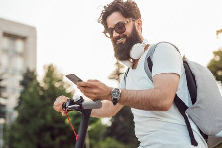 Smiling hipster using modern gadgets in everyday life Stock fotó