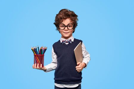 Clever schoolboy with stationery