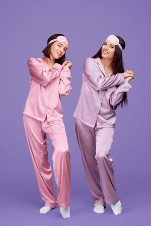 Playful fellows in nightwear posturing and having fun