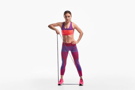 Strong lady exercising with resistance band