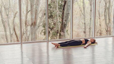 Woman resting during yoga training Stock Photo