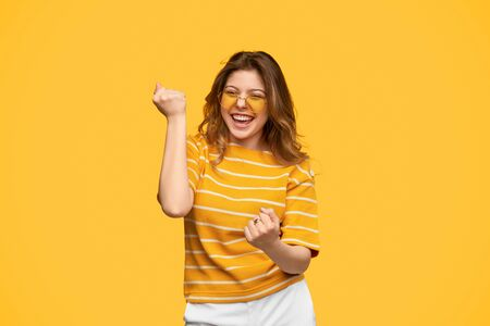 Cheerful hipster smiling celebrating success