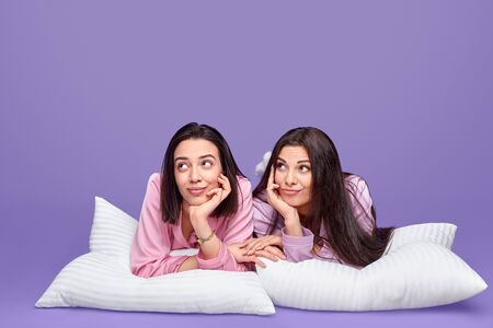 Dreamy women resting during slumber party Stock Photo