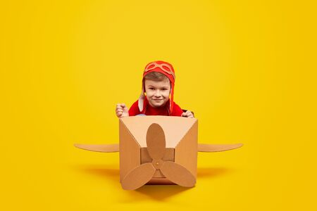 Confident little boy piloting plane