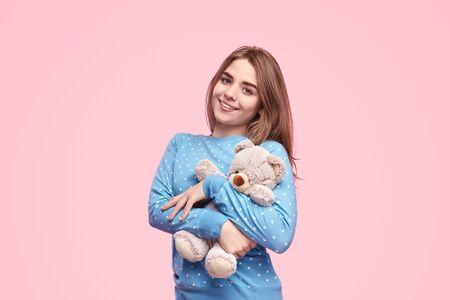 Cute teenager embracing teddy bear Stock Photo