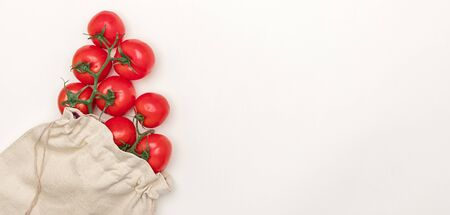Ripe tomatoes in cotton sack