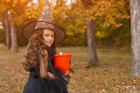 Pretty little witch with Jack or lantern bucket 版權商用圖片
