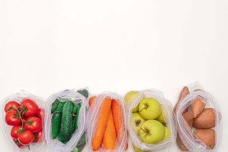 Cotton sacks with fresh vegetables