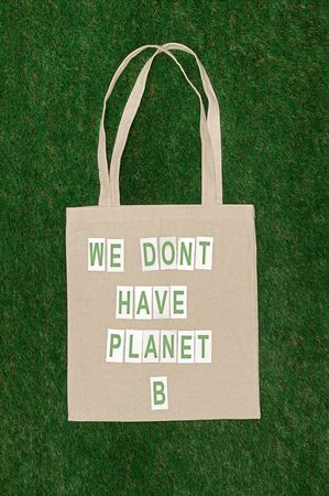 Cotton bag with ecological writing on lawn