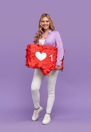 Cheerful female with social media sign 版權商用圖片