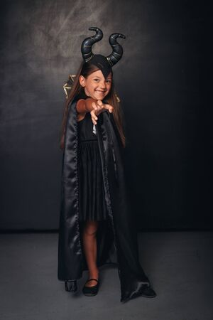 Cute girl in spooky devil costume