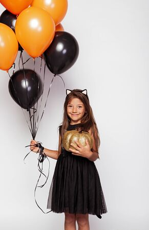 Happy girl with black and orange balloons
