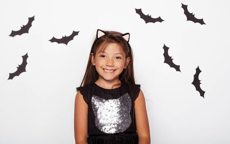 Attractive girl with cat ears and black bats 版權商用圖片