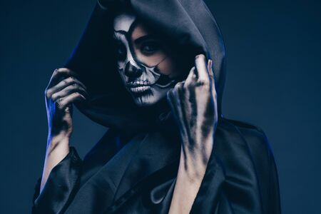 Mysterious female zombie in hooded cape