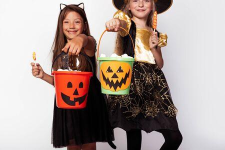 Happy girls with Jack o lantern buckets