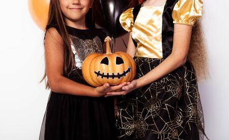 Faceless kids with decorated Jack o lantern
