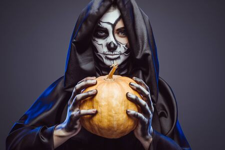 Creepy skeleton with small pumpkin