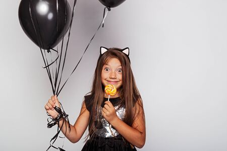 Funny girl with colorful lollipop