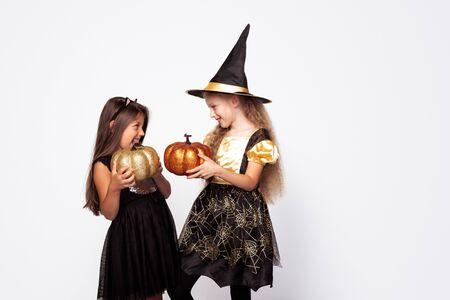 Playful girls with shiny Jack o lanterns