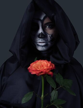 Mysterious witch with red rose