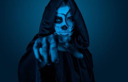 Female in Halloween costume pointing at camera 版權商用圖片
