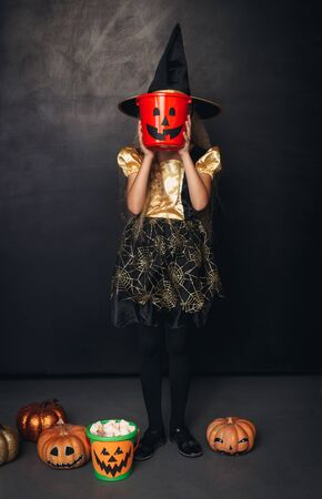 Girl with candy bucket used as mask