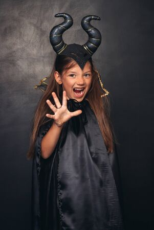 Scary girl in devil costume
