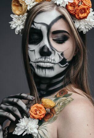 Devil woman with flower decor 스톡 콘텐츠