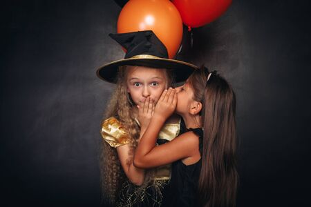 Funny girls with balloons sharing secret 版權商用圖片