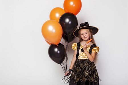 Pretty girl in Halloween witch costume