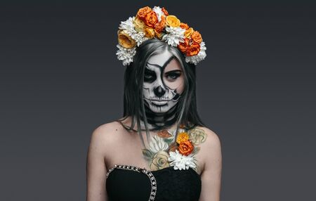 Serious witch with flowers on head