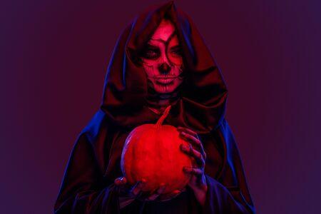 Creepy ghost with pumpkin under red light 版權商用圖片