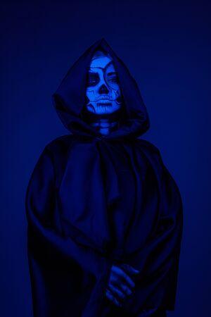 Bony lady in hooded cape Фото со стока