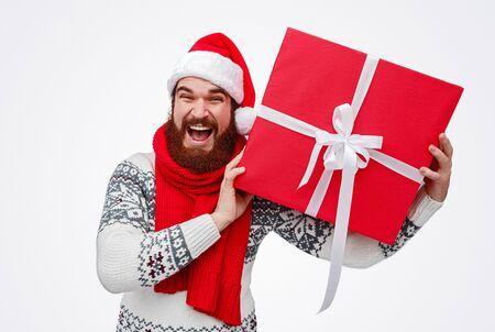 Excited male with big Christmas gift box 版權商用圖片