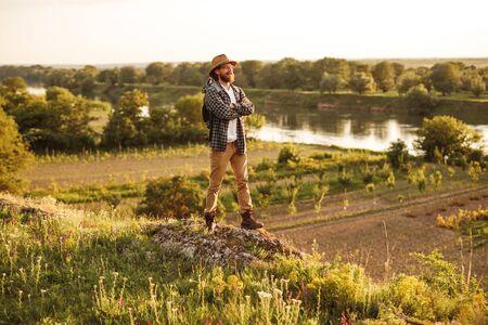 Confident explorer standing in nature 版權商用圖片
