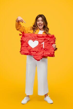 Optimistic woman advertising social media