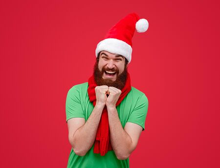 Excited Santa assistant looking at camera Stock Photo