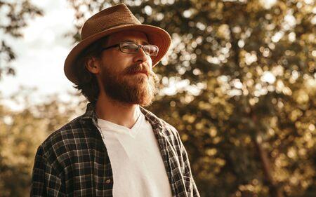 Dreamy bearded hiker in countryside