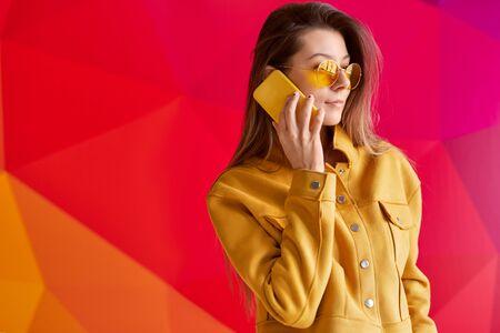 Trendy female talking on smartphone Stock fotó