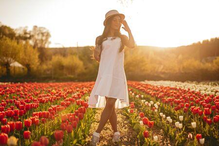 Sensual female standing in tulip field 版權商用圖片