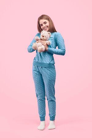 Childish teenager with teddy bear