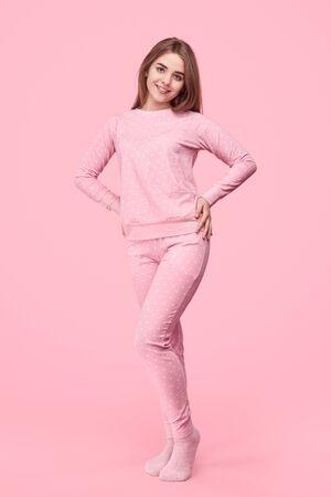 Smiling teen girl in warm pajama