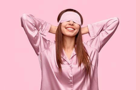 Rested woman in sleep mask Stock Photo