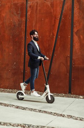 Urban male riding electric transport on street Stock fotó