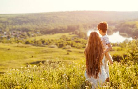Unrecognizable siblings spending time in nature