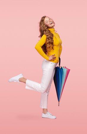 Excited lady with stylish umbrella